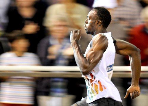 Usain Bolt sprints toward the finish line. (AP-Yonhap News)