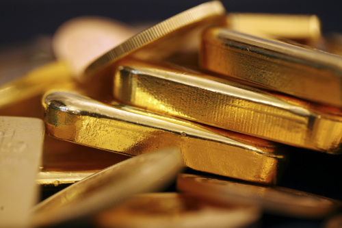 Gold bars and coins. (Bloomberg)