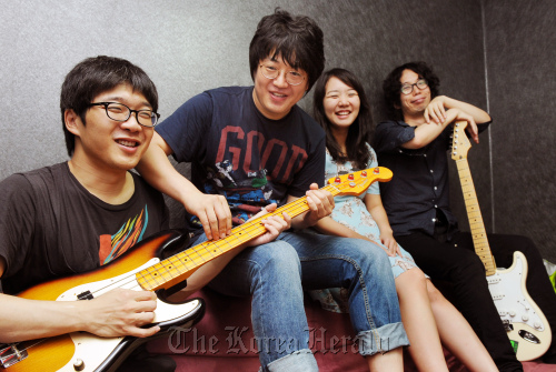 Nunco Band members, minus drummer Parang, pose for a photograph before an interview in Seoul: (From left) Mokmala on guitar, Slpny on bass, Yonrimog on keyboards and Kkamakgui on vocals. (Park Hyun-koo/The Korea Herald)
