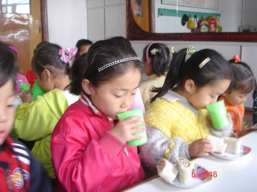 Children enjoy bread baked at one of LINK's existing bakeries in North Korea (LINK)