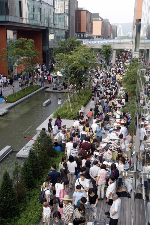Crowds bustle along Canal Walk during the Good Market in Songdo.