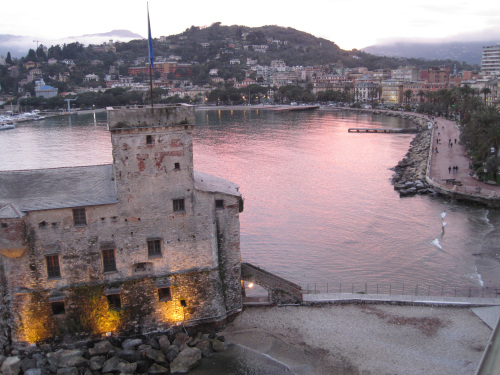 A hotel balcony offers splendid views of a 16th-century castle and a broad esplanade that hugs the shoreline of Rapallo in Italy. (MCT)