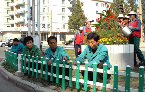 A photo released by North Korea's official Korean Central News Agency last Friday shows North Korean workers sprucing up Pyongyang. (Yonhap News)