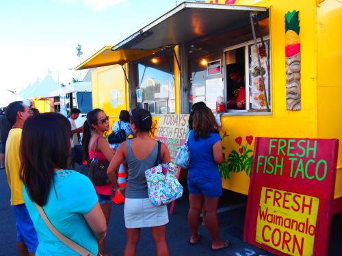 People wait to taste food at popular four-wheeled eateries in Honolulu.
