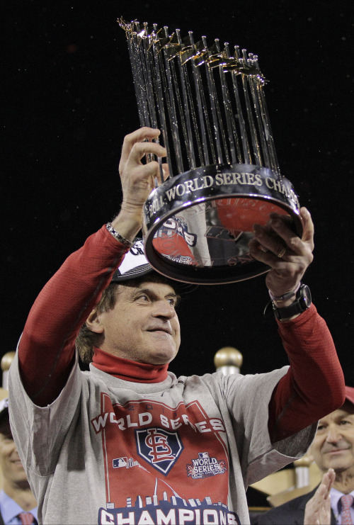 St. Louis Cardinals manager Tony La Russa celebrates with the World Series trophy. (AP-Yonhap News)