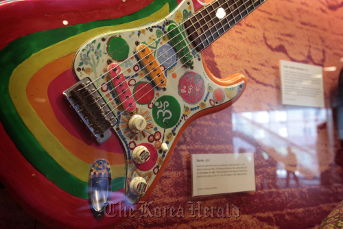 """George Harrison's brightly colored Stratocaster, """"Rocky,"""" is among the former Beatles memorabilia on display at the Grammy Museum in Los Angeles, California, Oct. 18. (Los Angeles Times/MCT)"""