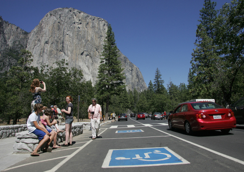 Tourists gather in a congested area of Southside Drive to view and take photos of El Capitan in Yosemite National Park in California. (AP-Yonhap News)