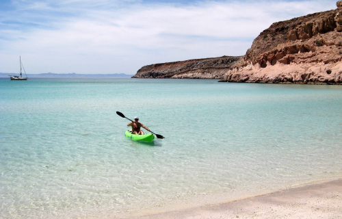 A kayaker approaches Ensenada Grande, on Isla Partida, called by some the most beautiful beach in Mexico. (Seattle Times/MCT)