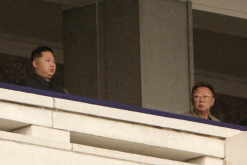 Kim Jong Il, leader of North Korea, left, looks towards his son Kim Jong Un, during a military parade commemorating the 65th anniversary of founding of the Workers` Party of Korea in Pyongyang, North Korea, on Sunday, Oct. 10, 2010. (Bloomberg)