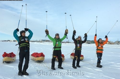 Members of the Korea expedition team celebrate after successfully crossing the Bering Strait on Wednesday. (The Korean Bering Strait Expedition Team)