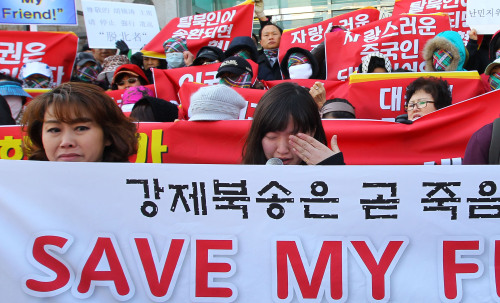 Protesters denounce China's repatriation of North Korean refugees at a rally in Jongno, Seoul. (Yonhap News)