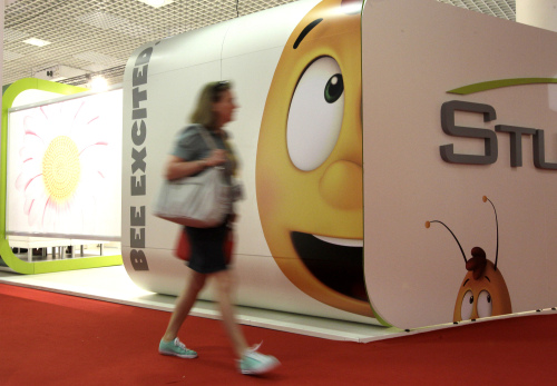 A visitor walks in front of a stand at the MIPTV Media Market on Monday in Cannes, France. (AP-Yonhap News)