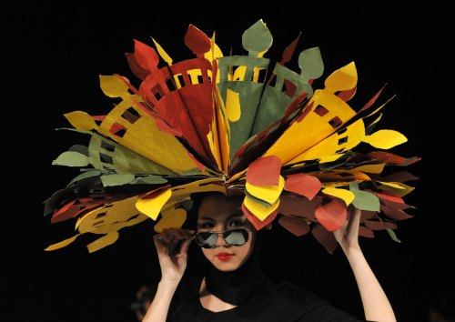 A model displays a creation by a group of Kyrgyz designers 'NAH' during a Fashion Week in Bishkek, on April 4 2012. (AFP)