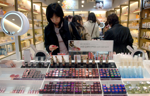 Customers look through cosmetics at a shop in Seoul. (Bloomberg)