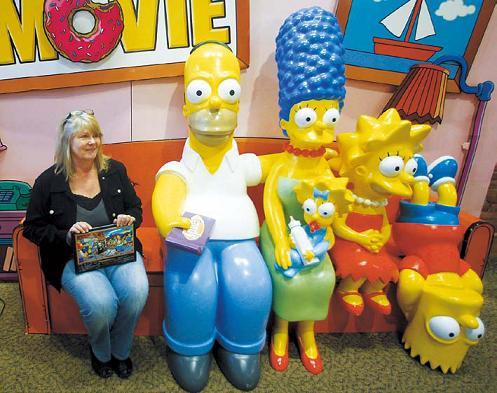 Debra Gruell, executive director of the Springfield Museum, sits on the The Simpsons Couch at the museum Tuesday, April 10, 2012, in Springfield, Oregon. (AP-Yonhap News)