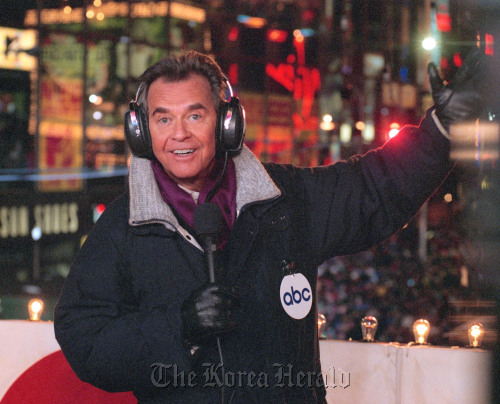Dick Clark hosts a New Year's Eve special from New York's Times Square. (AP-Yonhap News)