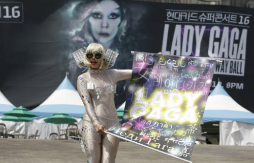 Japanese fan Shoko Kimura, dressed as US pop diva Lady Gaga, pose as she waits for Gaga's concert in front of the venue in Seoul, South Korea, Friday. (AP)