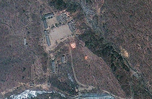 This April 18, 2012 satellite image provided by GeoEye appears to show a train of mining carts, at the lower center of the frame, and other preparations underway at North Korea's Punggye-ri nuclear test site, but no indication of when a detonation might take place, according to analysis by the U.S.-Korea Institute at Johns Hopkins School of Advanced International Studies. (AP-Yonhap News)