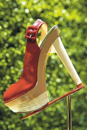 Shoes from the first ever retrospective exhibition by French shoe designer, Christian Louboutin, at the Design Museum, London, Monday.(AP-Yonhap News)