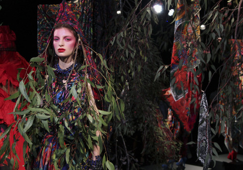 A model wearing designs by Jenny Lee stands in a display during Australian Fashion Week in Sydney, Thursday, May 3, 2012. Lee used natural props including leaves and branches from native Australian trees such as Gum Trees. (AP)