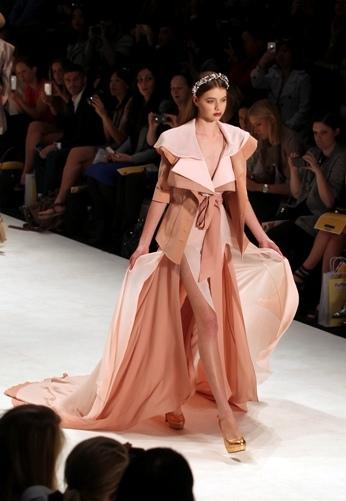 A model presents creations designed by South Korean Gabriel Lee during Australian Fashion Week in Sydney, Friday, May 4, 2012. (AP)