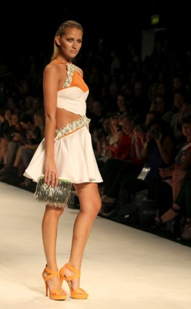 A model struts along the runway wearing a design by Cynthia Thai during Australian Fashion Week in Sydney, Thursday, May 3, 2012.(AP)