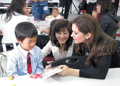 Danish Crown Princess Mary (right) talks to a young boy with KUMFA representative Mok Kyung-hwa at the the Korea Foundation for Women in Seoul on Tuesday. (Kirsty Taylor)