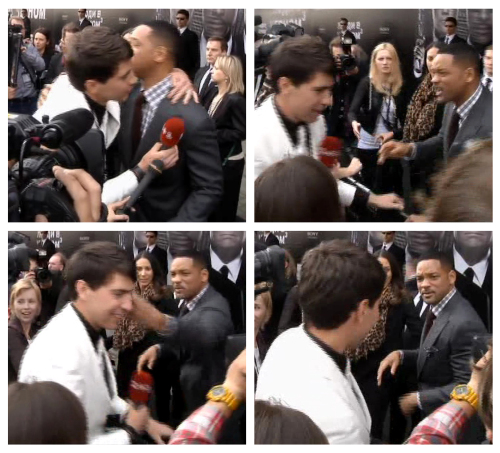 """In this photo combo of video images, Will Smith is embraced by reporter Vitalii Sediuk in white suit from the Ukrainian television channel 1+1, on the red carpet before the premiere of """"Men in Black III"""" on May 18 in Moscow. (AP-Yonhap News)"""