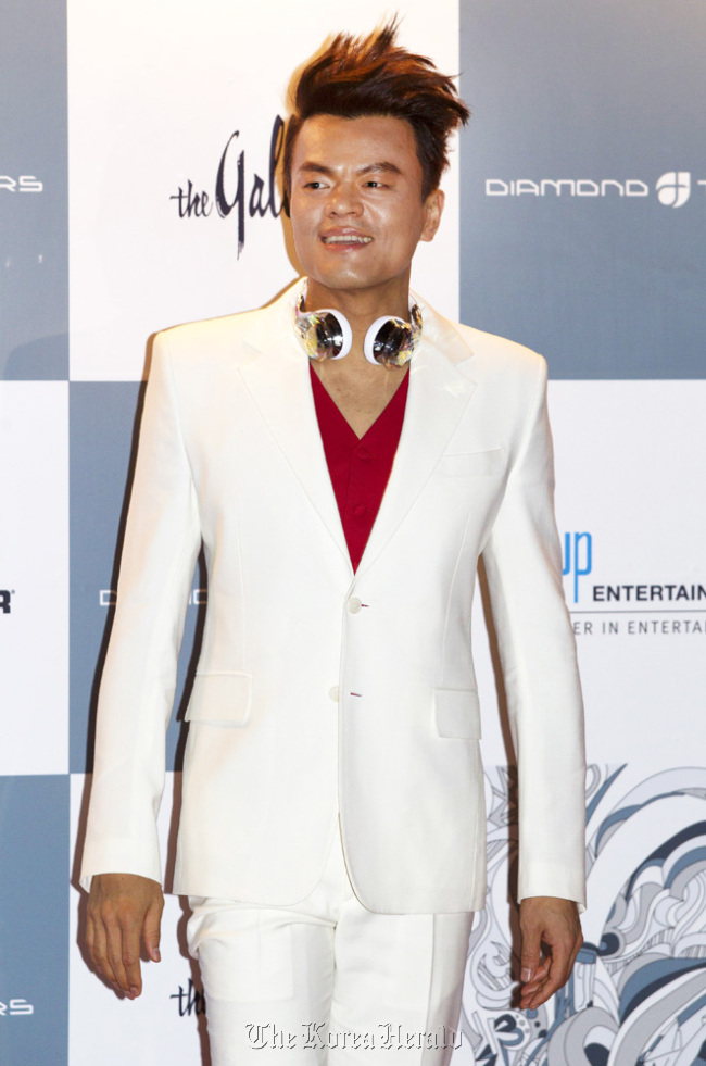 Park Jin-young poses at a launching ceremony for Monster Diamond Tears headphones designed by himself on Friday in Seoul. (Lee Young-ho)