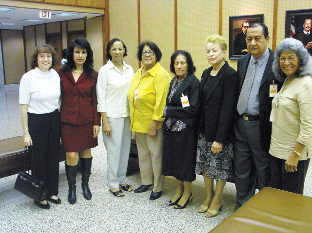 Attorneys Naomi Weinberg and Nitsana Darshan-Leitner (second left) with family members of terror victim Carmelo Calderon-Molina in the United States District Court in San Juan, Puerto Rico, during the 2010 trial to prove North Korea's involvement in the 1972 Lod Airport attack. (Shurat HaDin-Israel Law Center)