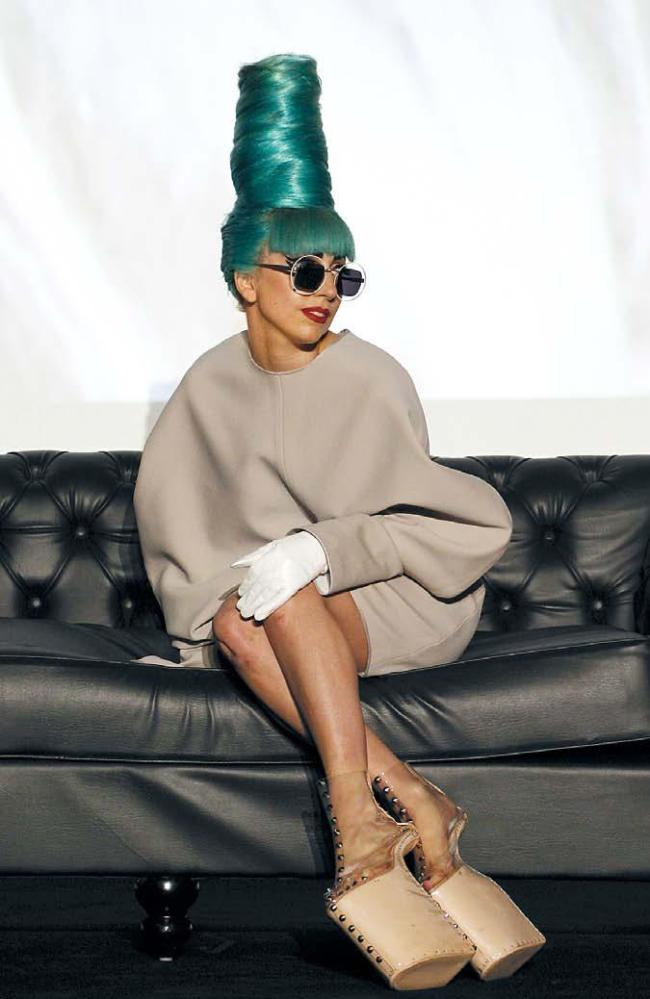 Lady Gaga gives a press conference ahead of a 2011 showcase concert wearing shoes created by Japanese shoe designer Noritaka Tatehana at the Marina Bay Sands in Singapore. (AP-Yonhap News)