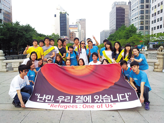 Participants in the World Refugee Day events in Seoul on Saturday pose for a picture during the celebrations. (Refugee Support Network of Korea)