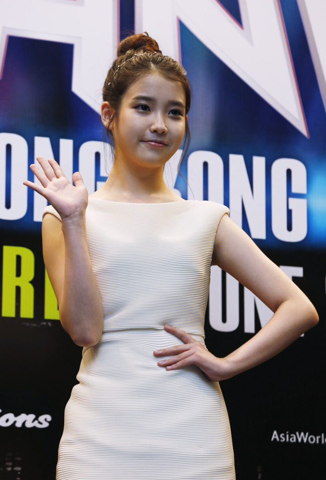 IU poses before her concert 'Music Bank' in Hong Kong Saturday June 23, 2012. Music Bank, the multi K-pop artists concert including South Korean music group TVXQ, Wonder Girls, Beast, CNBLUE, F(x), MBLAQ, Infinite and IU. (AP-Yonhap News)