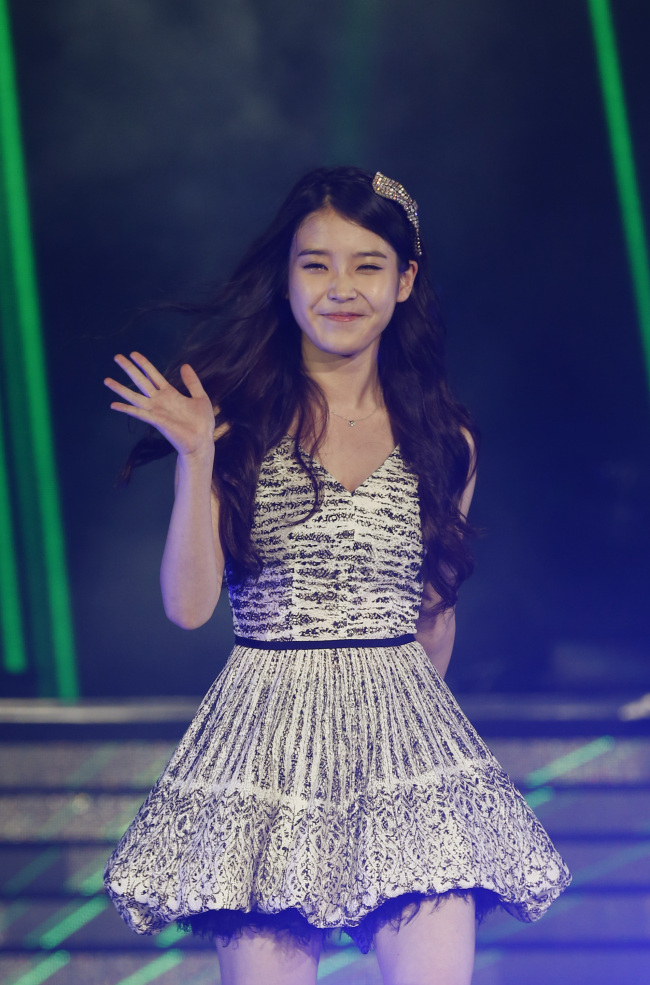 IU performs during her concert 'Music Bank' in Hong Kong Saturday (AP-Yonhap News)