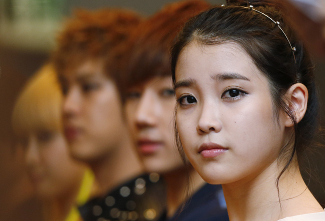 From left, South Korea singer IU, Seong Kyu, a member of music group 'Infinite', Seung Ho, a member of music group 'MBLAQ', and Victoria, a member of music group 'F(x)' attend a news conference before their concert 'Music Bank' in Hong Kong, Saturday, June 23, 2012. Music Bank, the multi K-pop artists concert including South Korean music group TVXQ, Wonder Girls, Beast, CNBLUE, F(x), MBLAQ, Infinite and IU. (AP-Yonhap News)