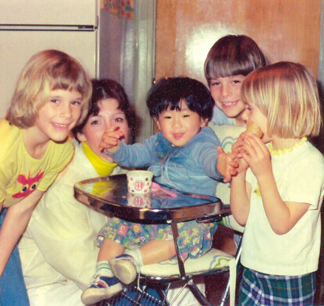 Korean-American Michael Holloway is pictured as a child with his adoptive family. (Mu Films)