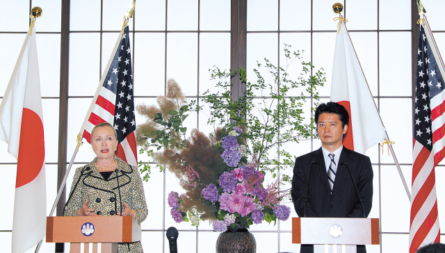 U.S. Secretary of State Hillary Rodham Clinton (left) speaks as Japanese Foreign Minister Koichiro Gemba listens during a joint press conference in Tokyo on Sunday. (AP-Yonhap News)