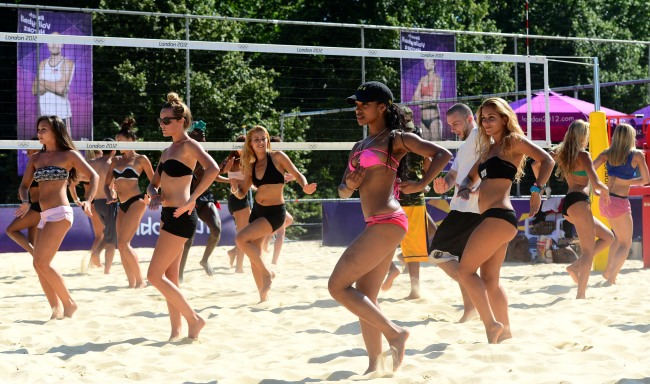Members of the Aicha Mckenzie Choreographer for Sports Presentation London 2012 perform a group dance at the St. James Park in London, Tuesday. London Olympic Joint Press Corps