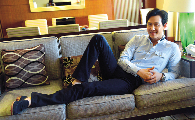 Actor Lee Jung-jae poses for a photo prior to an interview with The Korea Herald on Thursday. (Chung Hee-cho/The Korea Herald)