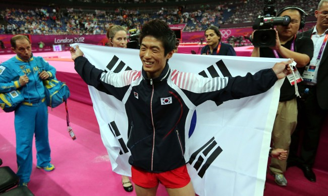Yang Hak Seon of South Korea celebrates winning a gold medal in the men's gymnastics vault final in the North Greenwich Arena during the London 2012 Olympic Games on Monday. (London Olympic Joint Press Corps)
