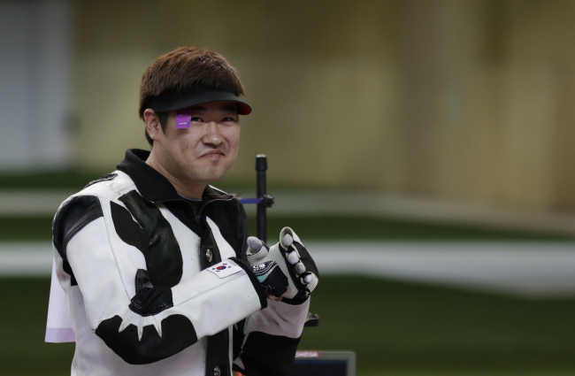 Kim Jong-hyun reacts as he realizes he has pulled into second to earn a silver medal, at the end of the men's 50-meter rifle 3 positions final, at the 2012 Summer Olympics, Monday. (AP -Yonhap News)