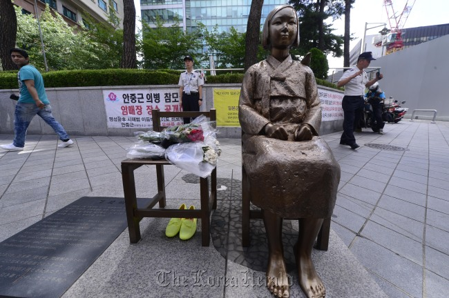 The bronze statue of a girl representing victims of Japanese World War II-era sexual slavery stands in front of the Japanese Embassy in Seoul.(Park Hae-mook/The Korea Herald)