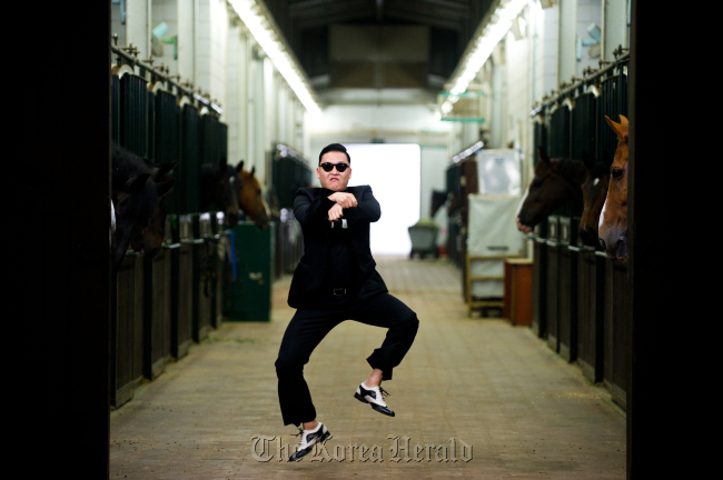 "Psy showcases his popular ""horseback riding"" dance in the music video to his hit single ""Gangnam Style."" (YG Entertainment)"