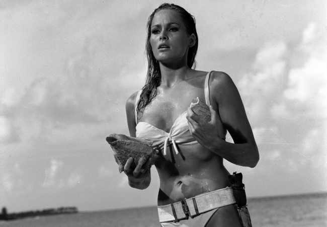 This undated publicity photo provided by United Artists and Danjaq, LLC shows Ursula Andress in a scene from the James Bond film,
