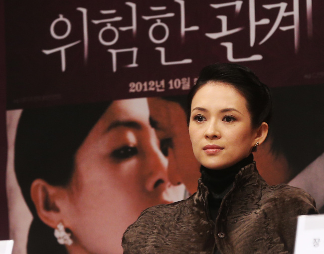 """Chinese actress Zhang Ziyi listens to a reporter's question during a press conference promoting her latest film """"Dangerous Liaisons"""" at Centum City Shinsegae in Busan, Friday. (Yonhap News)"""