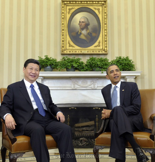 President Barack Obama sits with Chinese Vice President Xi Jinping at the White House in February. (AP-Yonhap News)