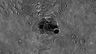 A 68-mile-diameter crater, large indentation at center, in the north polar region of Mercury (AP)