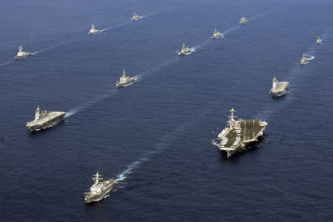 Twenty-six ships from the U.S. Navy and the Japan Maritime Self-Defense Force, including USS George Washington (bottom right) steam together in East China Sea after the conclusion of Keen Sword, a biennial naval exercise by the two countries to practice their response to a crisis in the Asia-Pacific region. ( AP-Yonhap News)