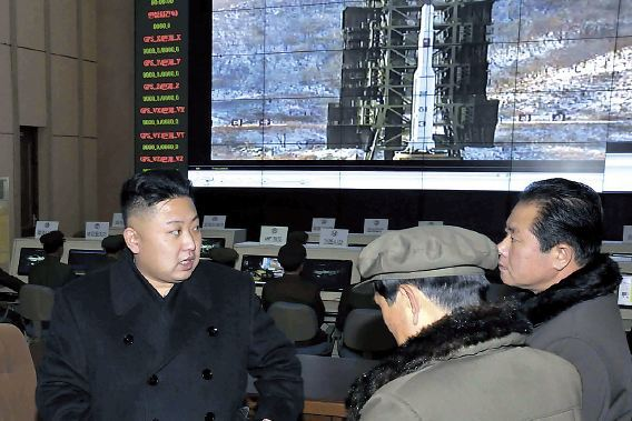 This undated photo released by the North's Korea Central News Agency shows leader Kim Jong-un meeting scientists at its rocket launch site in Cheolsan, Pyeongan Province. (Yonhap News)