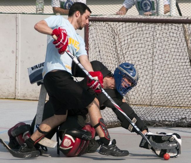 Rocky Mountain Tavern Fighting Cocks goaltender Bill Wiederseim stretches to make a glove save on Matt Levasseur of the Dillinger's Dudes during the 2012 fall season of Canada Ball Hockey Korea at Jamsil Sports Complex. (Andrei Cherwinski)
